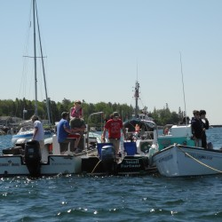'Like NASCAR and tractor pulling all wrapped into one': Lobster boats race in Stonington Harbor