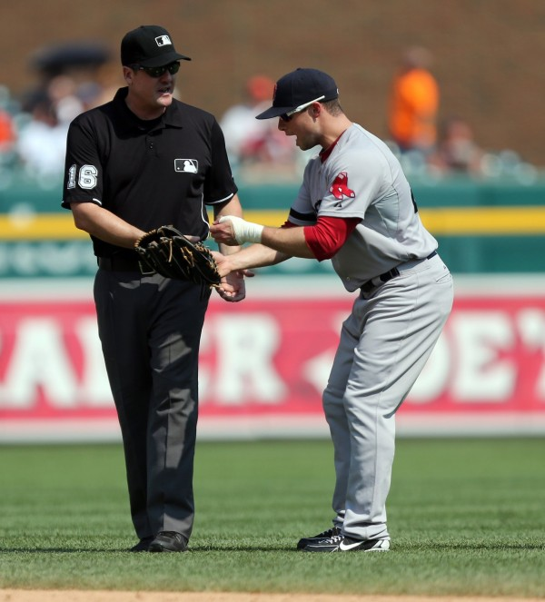 Boston right fielder Daniel Nava argues a call with second base umpire Mike DiMuro during eighth-inning action at Comerica Park in Detroit Sunday, June 23, 2013.