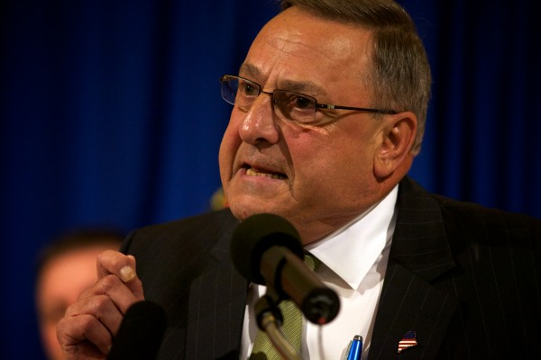 Gov. Paul LePage renews his pledge to veto the state budget at an Americans for Prosperity rally at the State House in Augusta Thursday.