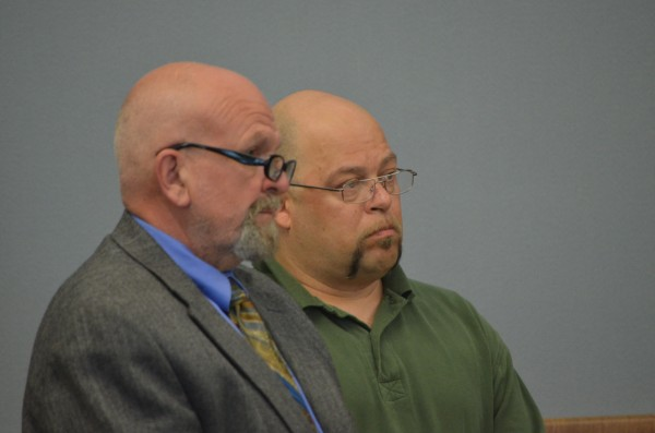 John Johnson (right) stands next to his defense attorney Randy Day during a sentencing hearing at Piscataquis County Superior Court on Tuesday, June 25, 2013. Johnson was sentenced to 16 years in prison for gross sexual assault and aggravated assault.