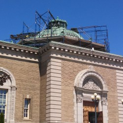 Crews installed scaffolding on the roof of Bangor Public Library on Wednesday, June 19, the day after voters overwhelmingly approved a $3 million loan to replace the century-old copper roof.