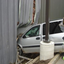 Distracted driver crashes minivan into building