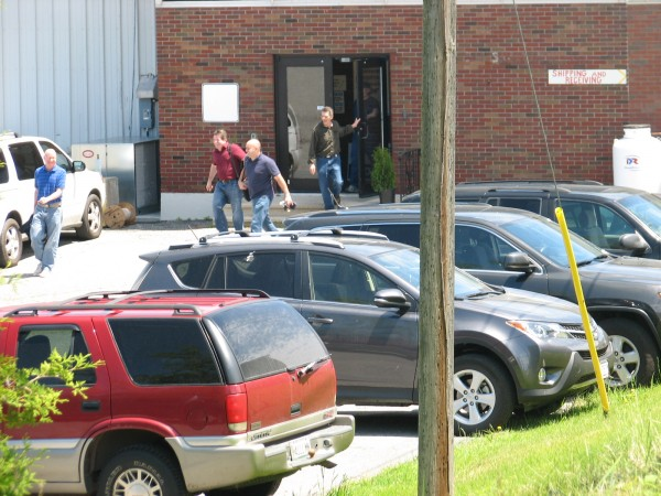 A group of people walk out of the Maine Fair Trade Lobster processing plant in Gouldsboro on Friday, June 21. The plant, which functioned for decades as a sardine cannery, has 90 new employees and is gearing up to begin processing lobster.