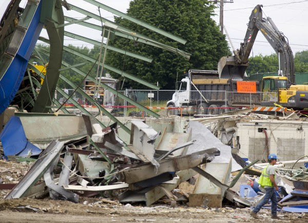 The final standing structures at the old Bangor Auditorium were torn down Thursday, June 27, 2013, bringing crews closer to finishing a project that started less than a month ago on June, 3 2013.