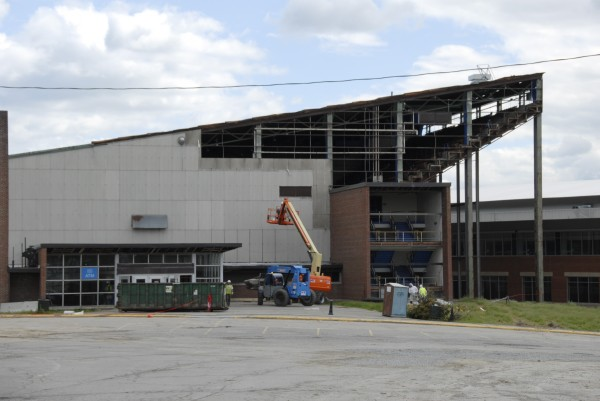 Exterior wall panels and windows are being removed from the Main Street side of the Bangor Auditorium on Tuesday, June 4, 2013. The building is being demolished to provide parking space for the Cross Insurance Center.