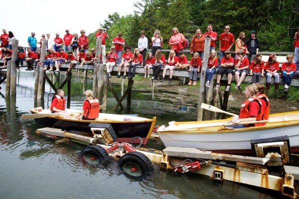 South Bristol eighth-graders get ready to row their skiffs as they are launched in South Bristol on Friday.