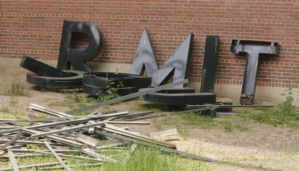 The metal letters formerly installed on the east end of the Bangor Auditorium can be seen on the ground after having been removed from the defunct community facility as seen on June 6, 2013.
