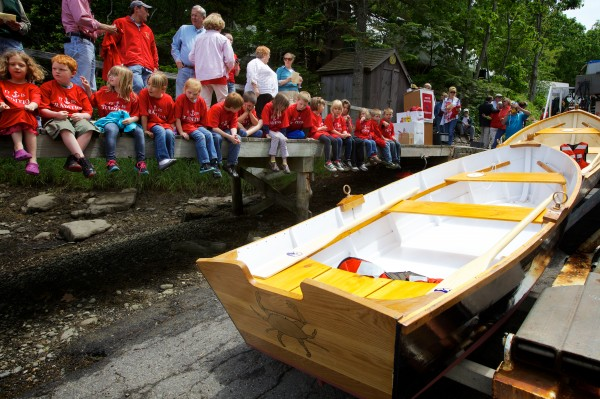 Every student from the South Bristol School, along with parents and townsfolk, turned out to watch the launching of two skiffs Friday, made by eighth-graders at the Maine Maritime Museum's boat shop.