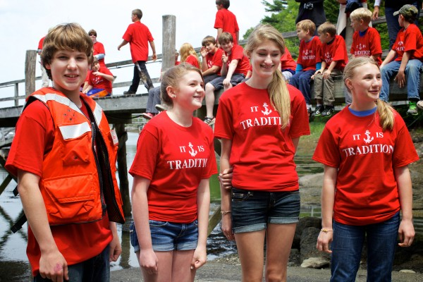 South Bristol School eighth-graders Tyler Giles (from left), Jillian Page, Julianna Preston and Jordan Farrin get ready to launch two skiffs they made with classmate Thalia Eddyblouin on Friday in South Bristol.
