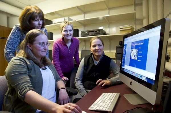 Members of the University of Maine Department of Communication Sciences and Disorders, graduate student Taylor Rodgers (from left), professor Judy Walker, graduate student Janet Ciejka, and instructor/lecturer Casey Monnier demonstrate the new speech therapy telepractice technology in February.