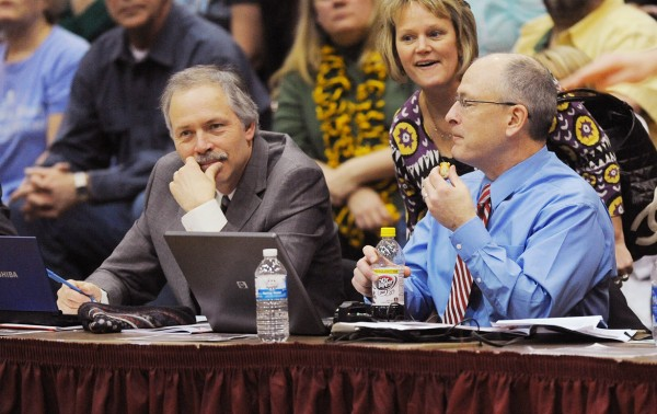 BDN sportswriters Dave Barber and Pete Warner pause to say hello to Peggy Kimball during a break in basketball tourney action at the Bangor Auditorium in February 2013. After nearly 40 years at the BDN, Dave Barber is retiring.