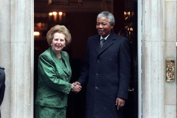African National Congress leader Nelson Mandela is greeted by British Prime Minister Margarat Thatcher in 1990.