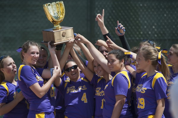 The Bucksport High School softball team holds the golden State Class C trophy after winning their championship game against Madison Area Memorial High School in Brewer, Maine Saturday, June 15, 2013.