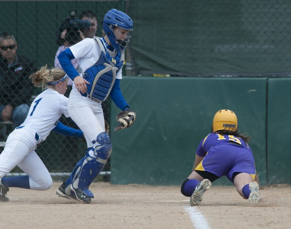 Bucksport High School softball player Debbie Wight (15) steals home just ahead of the tag by Madison third base player Savanna Kandiko (1)  inn the fourth inning  of their championship game against Madison Area Memorial High School in Brewer, Maine Saturday, June 15, 2013.