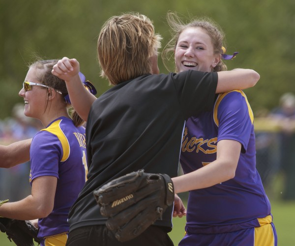 Bucksport High School softball pitcher Cassidy Adams is hugged by assistant coach Michelle Grindle after the final out in the seventh inning  of their championship game against Madison Area Memorial High School in Brewer, Maine Saturday, June 15, 2013.