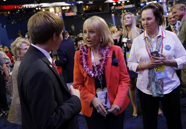 Arizona Gov. Jan Brewer, shown here greeting delegates Aug. 28, 2012, at the Tampa Bay Times Forum in Tampa, Fla., is one of several Republican governors pushing state legislators to approve Medicaid expansion allowed under the federal Affordable Care Act.