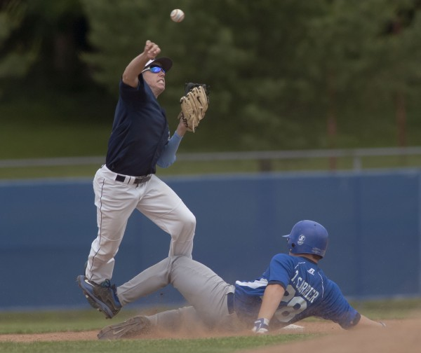Stearns High School baseball player Tanner Carrier (28) is tagged out by Dirigo player Nick Young in a double-play attempt in the second inning of their State Class C Championship game at Mansfield Stadium in Bangor, Maine Saturday, June 15, 2013.