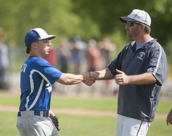 As Stearns High School baseball pitcher Jordan Morrow leaves the game  in the sixth inning he is commended by Dirigo coach Ryan Palmer in their State Class C Championship game at Mansfield Stadium in Bangor, Maine Saturday, June 15, 2013.