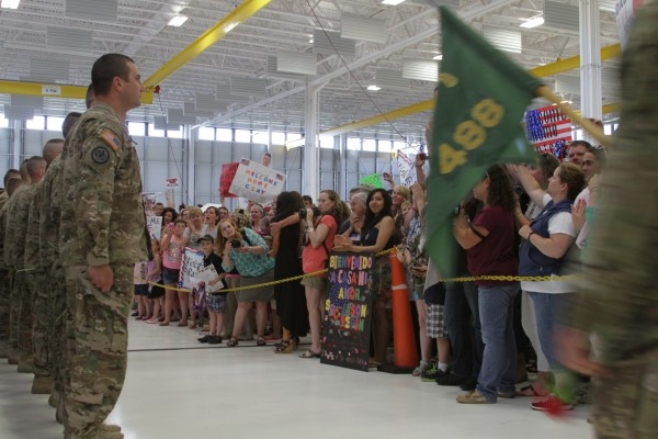 A hangar at Bangor is filled with family, friends and loved ones as troops return from Afghanistan on Saturday.