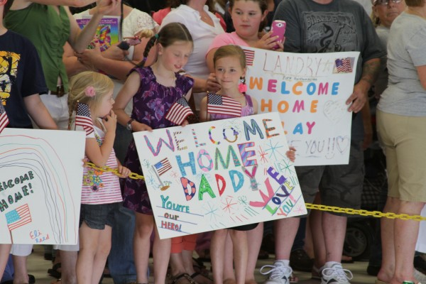 A hangar at Bangor is filled with family, friends and loved ones awaiting the returning troops Saturday.