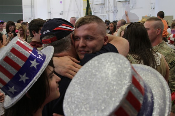 John Carter of Bucksport is greeted by his whole family, wife, parents, grandparents, brothers, sisters, sisters-in-law, brothers-in-law, nieces and nephews.