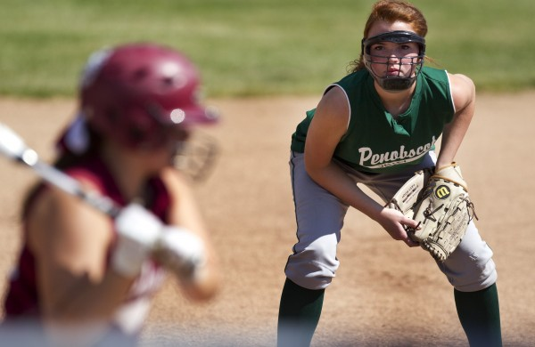 Penobscot Valley third baseman Shaelyn Jones wears a face mask while playing close to home plate against Richmond in the Class D softball state championship in Standish, Saturday, June 15, 2013.