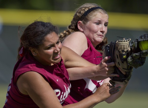 Richmond's second baseman Kelsea Anair, right, makes a catch on a pop fly as she collides with first baseman Kelsi Obi, left, in the Class D softball state championship against Penobscot Valley in Standish, Saturday, June 15, 2013.