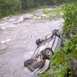 A former Coplin Plantation town clerk landed her vehicle roof down in the Carrabassett River at noon Friday. A runner spotted her lights while running along the Narrow Gauge Trail, according to Carrabassett Valley Police.