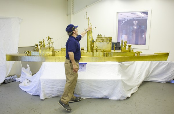 An Orland man, with the help of a metal fabrication company, has restored a 14-foot long brass boat model formerly used by the Navy to test antenna arrays on warships.