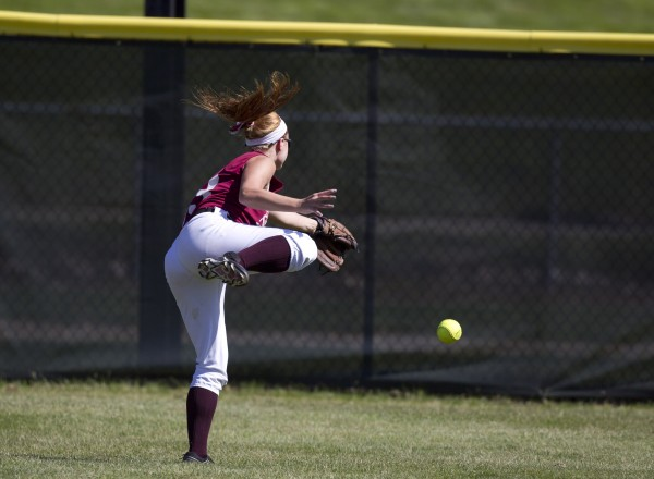 Richmond center fielder Noel Acord can not get back fast enough to make the catch on a hit that went for a triple by Penobscot Valley's Bethany Heald on the Class D softball state championship in Standish, Saturday, June 15, 2013.