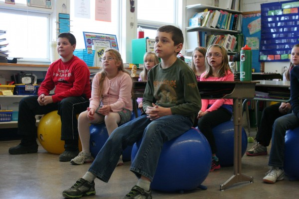 Students at the Dr. Levesque Elementary School in Frenchville participated in a pilot project that replaced classroom chairs with stability balls. Pictured are (in front, from left) Jonah Babin, Chyanne Price, and Andrew Oakes, (in back, from left) Lauren Paradis, Savanah Hanlin, Caitlin Chasse and Morgan Corriveau.