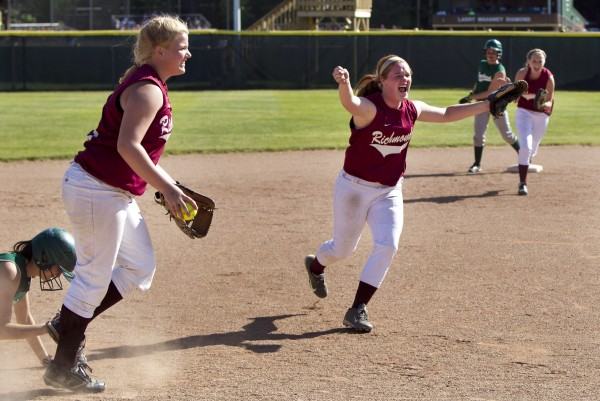 Richmond shortstop Kayla Patterson, center, rejoices after throwing to third base for the final out in the Bobcats' Class D softball state championship over Penobscot Valley in Standish, Saturday, June 15, 2013.
