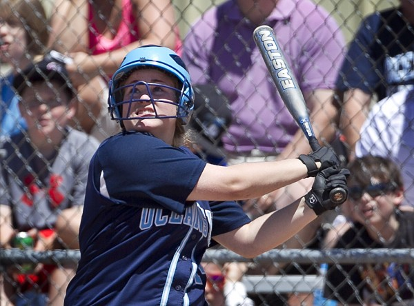 Oceanside's Kennadi Grover watches her hit travel to right field during the Class B softball state championship game against Greely in Standish.The winning runs were scored on the play.
