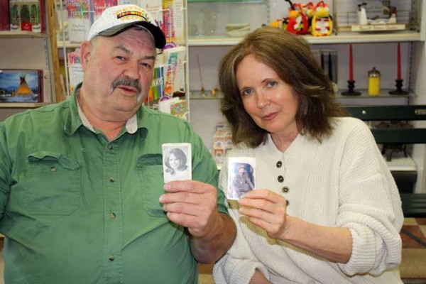 Author Cathie Pelletier of Allagash and Vietnam veteran Errol Hunt of Sherman, who briefly exchanged a few letters while Hunt served in Vietnam finally met for the first time some 40 years later in Aroostook. Shown here last month at York's Books in Houlton, Hunt holds a photo of Pelletier that she sent him in one of the letters and that he kept all those years, while Pelletier displays a photo of the veteran jumping out of an airplane.