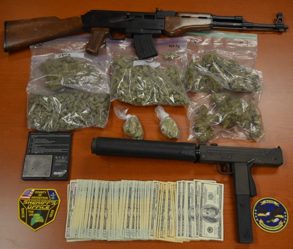 Guns and drugs allegedly seized from the home where Keith Jordan of Castle Hill was living. Jordan and his girlfriend, 31-year-old Daween Waugh, of 2880 State Road, were arrested by the Aroostook County Sheriff's Department and the Maine Drug Enforcement Agency after drugs and guns were discovered in their home.