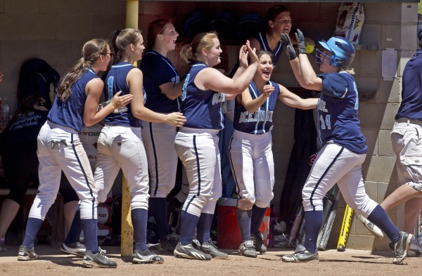 Oceanside's Kennadi Grover, right, is congratulated by teammates after scoring the Mariners' third run during the Class B softball state championship game in Standish. Grover's hit to right field drove in the winning runs.