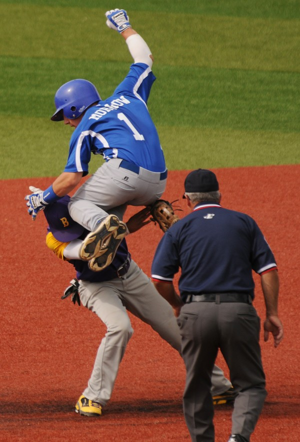 Stearns' Jordan Morrow collides with Bucksport's Josh Gray as he tries to leap over him on his way to second base during fourth-inning action. Morrow was ruled safe after Gray droped the ball.