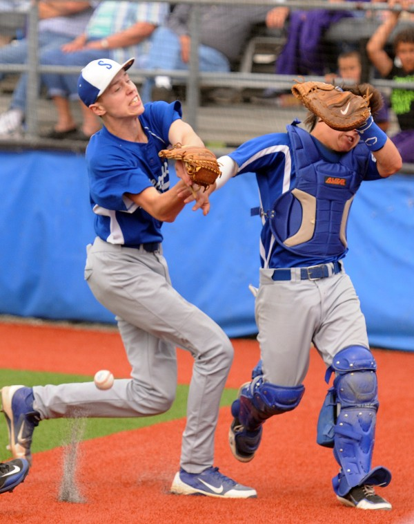 Stearns pitcher Kyle McVey, left and catcher Jordan Morrow collide as they both chase down a foul ball during seventh-inning action against Bucksport on Thursday.