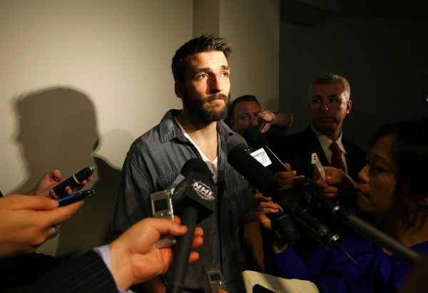 Boston Bruins center Patrice Bergeron answers questions during a news conference after Game One of the NHL Stanley Cup Finals in Chicago on Thursday.