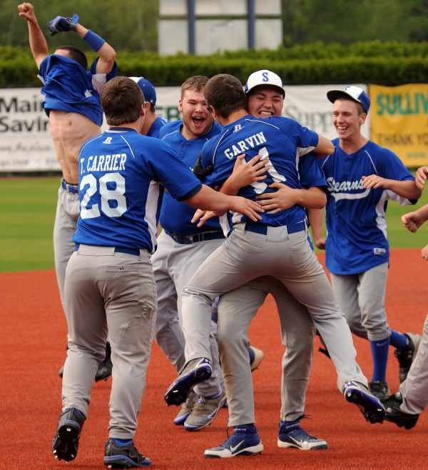 Members of the Stearns baseball team celebrates its victory over Bucksport 1-0 in Orono on Thursday.