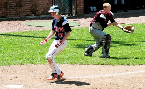 Bangor Christian's Seth Pearson easily makes it home as Buckfield's Jared Eastman catches a throw from the outfield during the Class D State Championship Saturday in Standish.