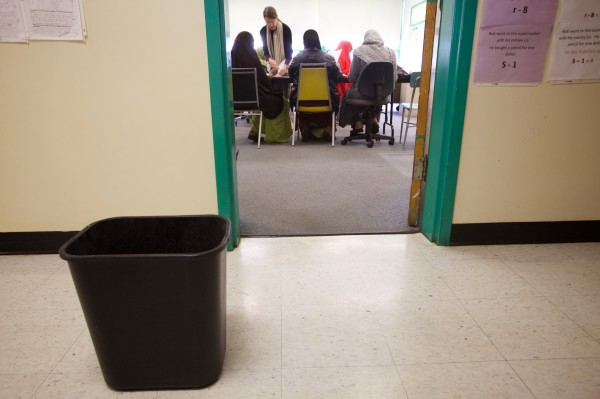 A trash bin collects rainwater in the hallway at Portland Adult Education on Wednesday.