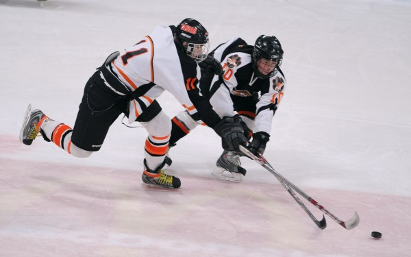 Winslow's Sean Bougeois (left) and Gardiner's Michael Hersom battle for the puck during the Eastern Maine Class B final at Alfond Arena in Orono in 2008.
