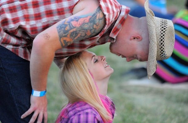 JT Hellum leans down to kiss his girlfriend Sarah Knight as they waited to see the Darius Rucker concert in Bangor. They came from Ellsworth to see the concert.