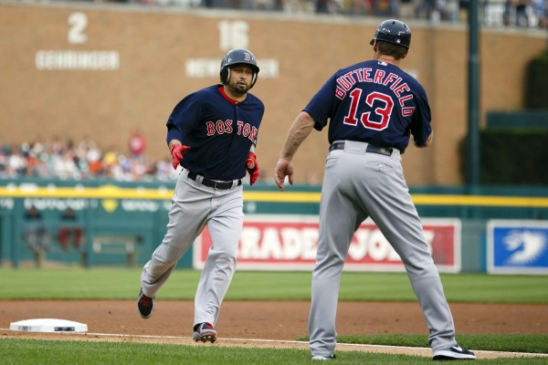 Boston's Shane Victorino receives congratulations from third base coach Brian Butterfield after he hit a home run in the first inning against the Detroit Tigers at Comerica Park in Detroit Friday night.