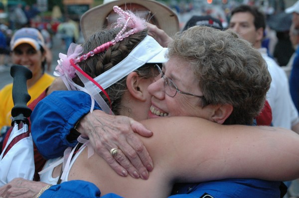 Linda Sue Saxton (right) hugs her daughter, Theresa Saxton after she finishes a race. Theresa, a personal trainer, will complete a one-woman Ironman as part of the Alzheimer's Association's Longest Day event.