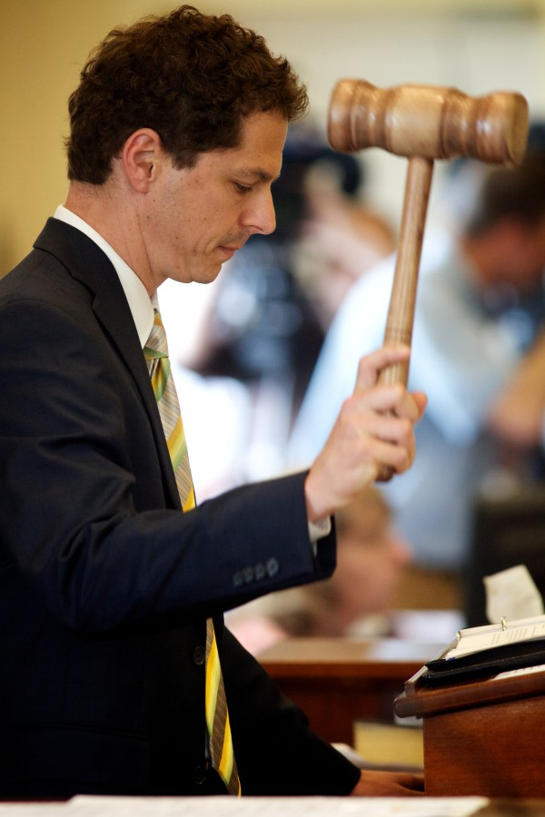 Senate President Justin Alfond, D-Portland, strikes his gavel Wednesday, enacting a $6.3 billion budget over the governor's veto.
