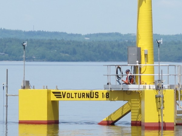 A worker awaits the word to power up VolturnUS, the first-of-its-kind wind turbine, designed and built at the University of Maine, which became the first grid-connected offshore wind turbine in the Americas to provide electricity to the power grid on Thursday.