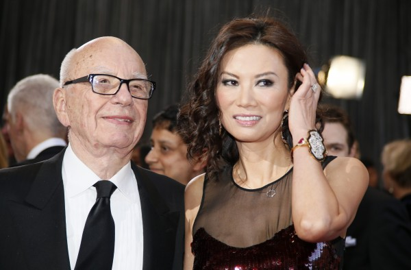 Rupert Murdoch, chairman and CEO of News Corporation, arrives with his wife Wendi Deng at the 85th Academy Awards in Hollywood, California in February  2013.