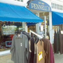"Pennell's clothing store on Maine Street in Brunswick is on the market. Owners David Girardin and John Simonson are looking for ""just the right buyer."""